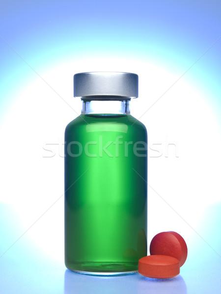 Küçük şişe hapları tok yeşil sıvı Stok fotoğraf © antonprado