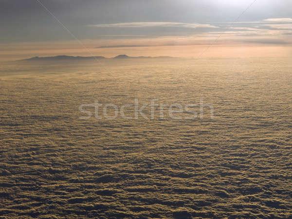 Nuvens sol acima montanha céu Foto stock © antonprado