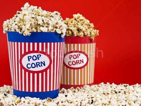 Stok fotoğraf: Iki · patlamış · mısır · kutu · mavi · eğlence · tiyatro