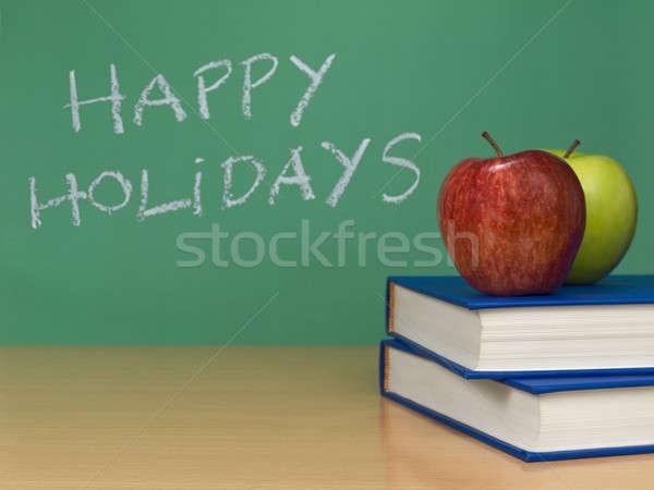 Feliz férias escrito quadro-negro dois maçãs Foto stock © antonprado