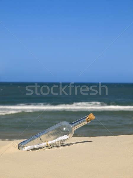 Foto stock: Garrafa · mensagem · dentro · enterrado · praia