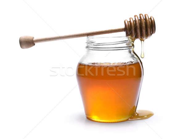 Miel jar bois haut isolé blanche Photo stock © antonprado