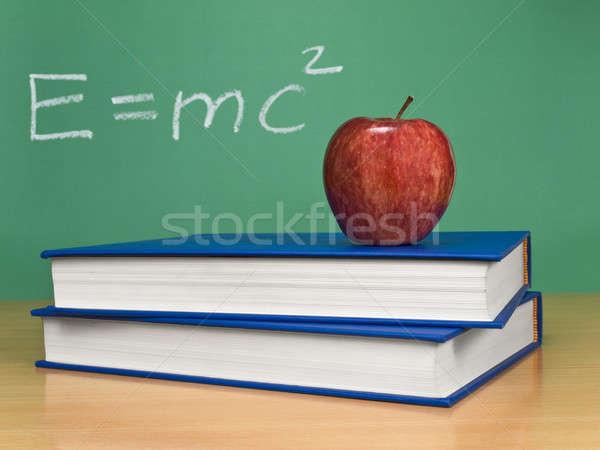 Teoria formula lavagna mela libri primo piano Foto d'archivio © antonprado