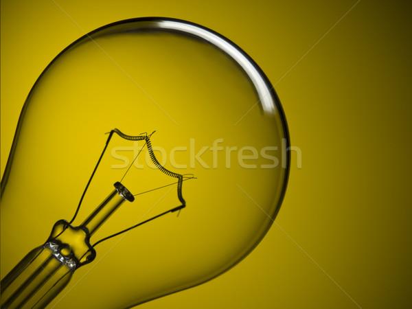 Stock photo: Light bulb over yellow