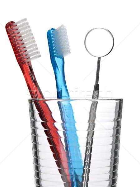 Oral ferramentas dois escova de dentes boca espelho Foto stock © antonprado
