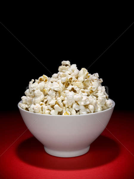 Popcorn puchar pełny Spotlight domu film Zdjęcia stock © antonprado