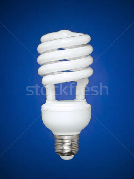 Fluorescent light bulb over blue Stock photo © antonprado
