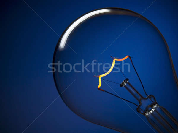 Bulb light over blue Stock photo © antonprado