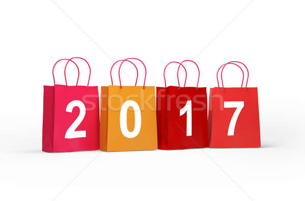 Colourful shopping bags with 2017. Concept of discount. Cube characters paper in paper bags. Stock photo © AptTone