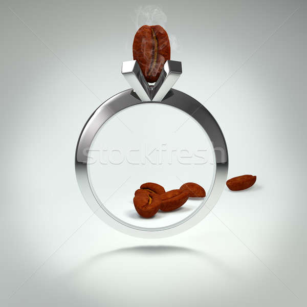 Ring inlaid with coffee bean. The great popularity and high quality coffee worldwide concept. Stock photo © AptTone