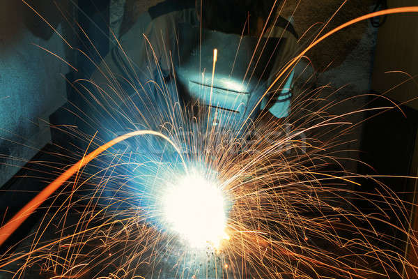 Stock photo: Industrial Worker at the factory welding closeup