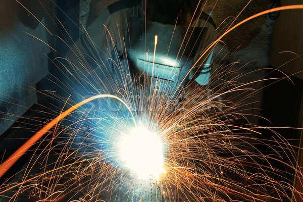 Industriali lavoratore fabbrica saldatura primo piano fuoco Foto d'archivio © arcoss