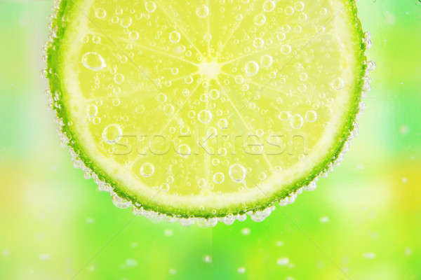 Close-up of a lemon slice with bubbles  Stock photo © arcoss