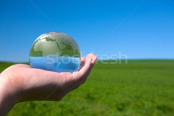 Glass earth in human hand Stock photo © arcoss