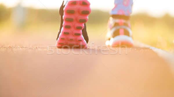 Runner feet running on road closeup on shoe. woman fitness sunri Stock photo © arcoss