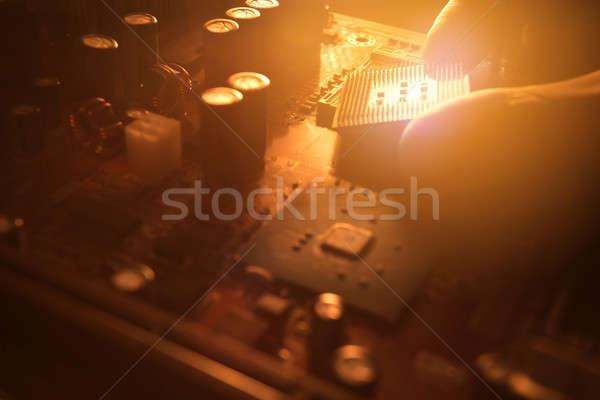 Technician plug in CPU microprocessor to motherboard socket Stock photo © arcoss
