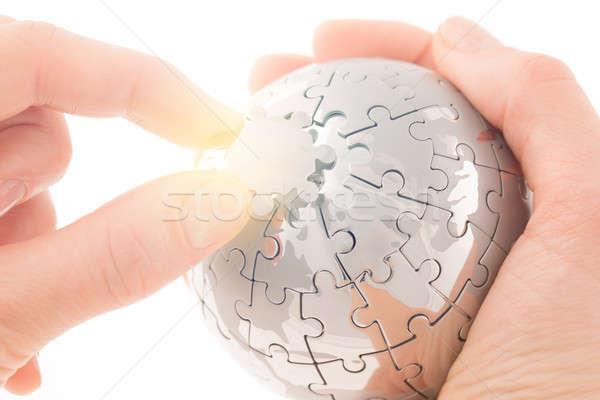 Affaires main bâtiment puzzle monde blanche Photo stock © arcoss