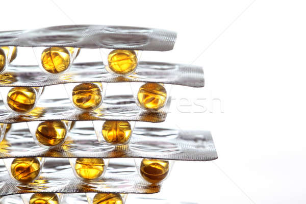 fish oil pills on white background  Stock photo © arcoss