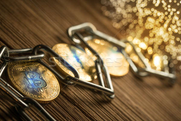 Stock photo: Bitcoin with chain, on wood background