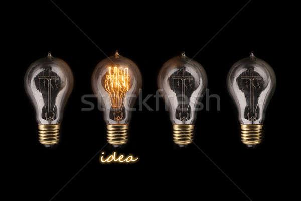 Egy izzó villanykörte egyéb villanykörték ötlet Stock fotó © arcoss
