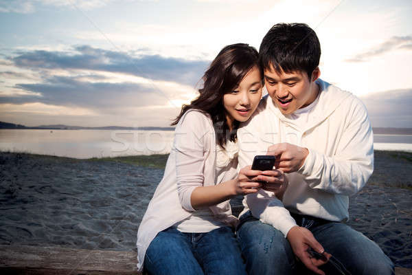 Asian couple texting Stock photo © aremafoto