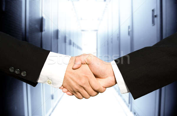 Businessmen shaking hands Stock photo © aremafoto