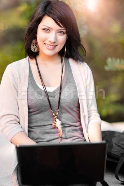 Stock photo: Mixed race college student with laptop