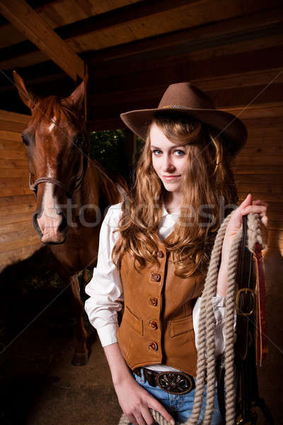 Beautiful caucasian cowgirl with a horse Stock photo © aremafoto