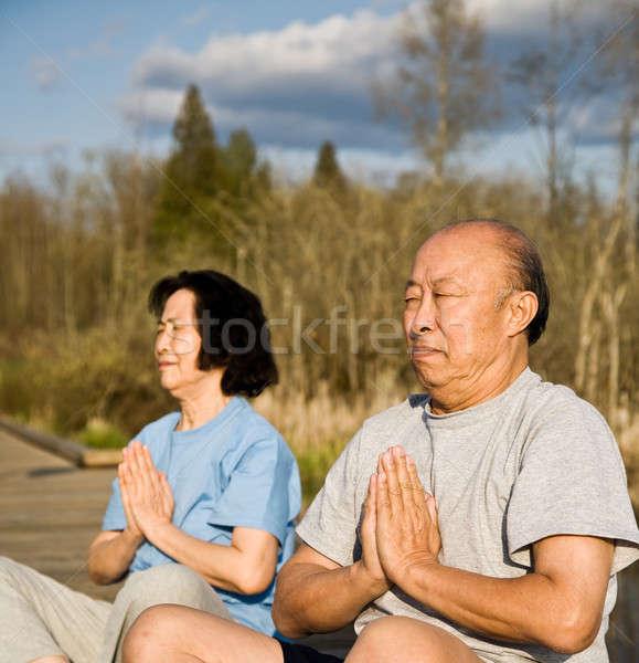 Actief senior asian paar yoga meditatie Stockfoto © aremafoto