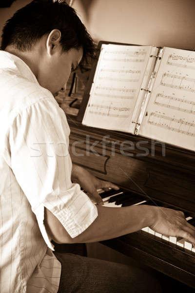 Asian man playing piano Stock photo © aremafoto