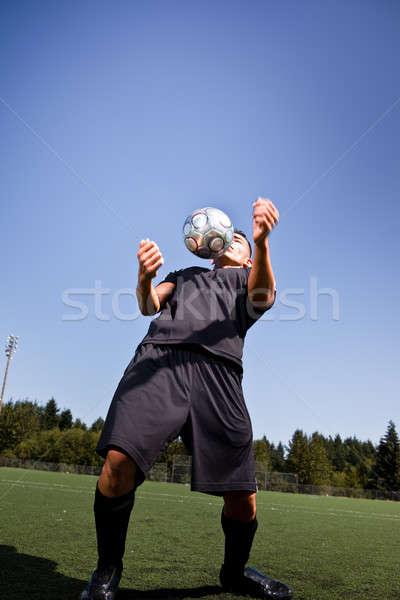 Сток-фото: Hispanic · Футбол · футболист · футбольным · мячом · выстрел · мяча
