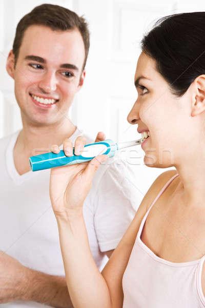 Couple brushing teeth in the bathroom Stock photo © aremafoto
