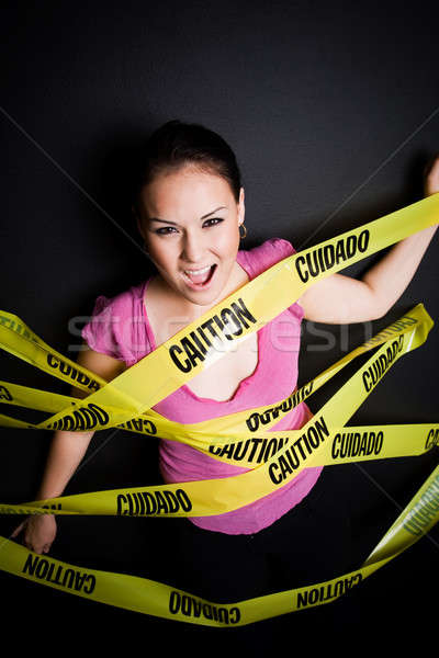 Businesswoman trapped in caution tape Stock photo © aremafoto