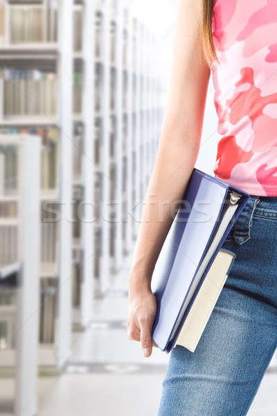 Diák könyvtár lövés hordoz könyvek nő Stock fotó © aremafoto