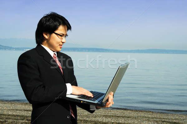 Businessman on the beach Stock photo © aremafoto