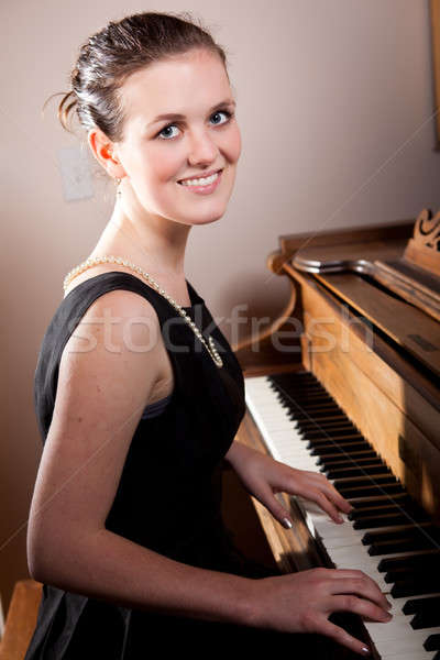 Beautiful teenager playing piano Stock photo © aremafoto