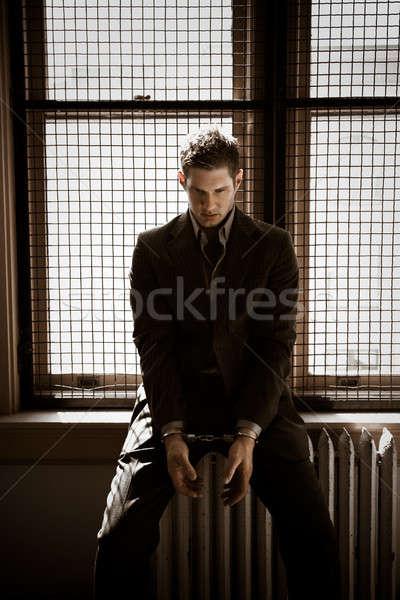 üzletember börtön kaukázusi ül megbilincselve üzlet Stock fotó © aremafoto