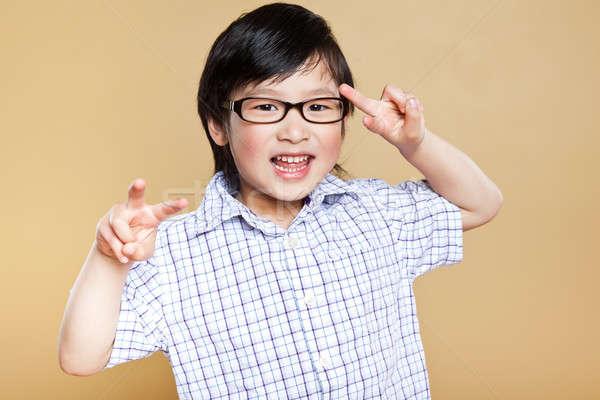 Aranyos ázsiai fiú portré készít vicces arc Stock fotó © aremafoto