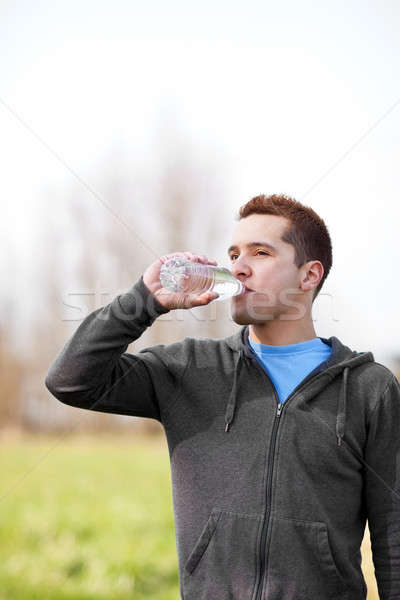 Stock photo: Mixed race man drinking water
