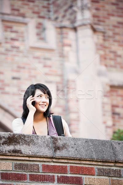Stock photo: Mixed race student on the phone