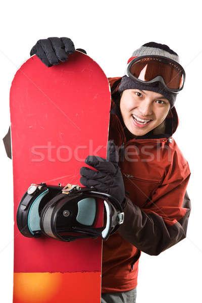Snowbordos izolált lövés ázsiai boldog férfi Stock fotó © aremafoto