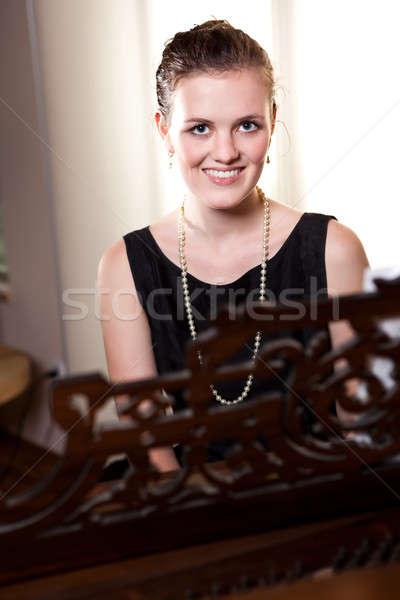 Beautiful teenager playing piano Stock photo © aremafoto