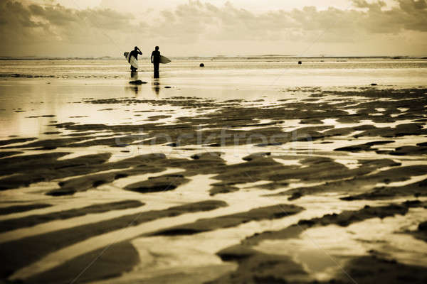 Stock photo: Surfers at the beach