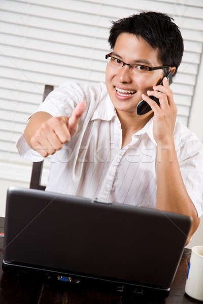 Asian entrepreneur thumbs up Stock photo © aremafoto