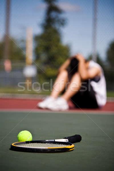 Szomorú teniszező vereség férfi ül lefelé Stock fotó © aremafoto