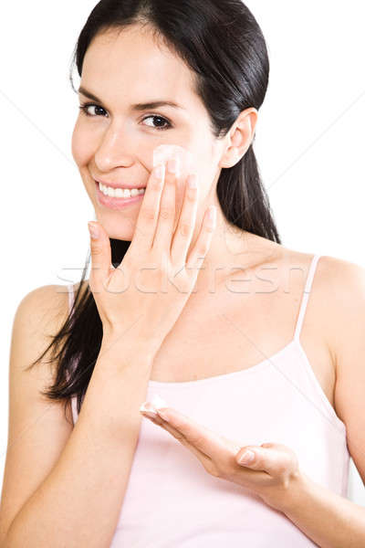 Woman applying lotion Stock photo © aremafoto