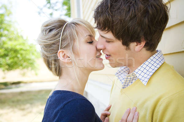 Stock photo: Young caucasian couple kissing