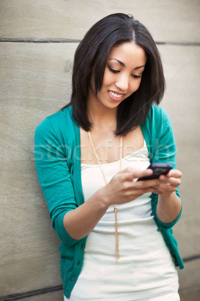 Black woman texting Stock photo © aremafoto