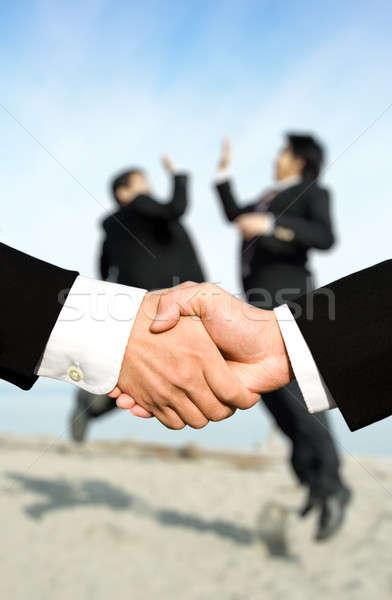 Sucesso empresários aperto de mãos dois outro Foto stock © aremafoto