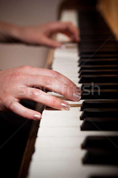 Woman playing piano Stock photo © aremafoto
